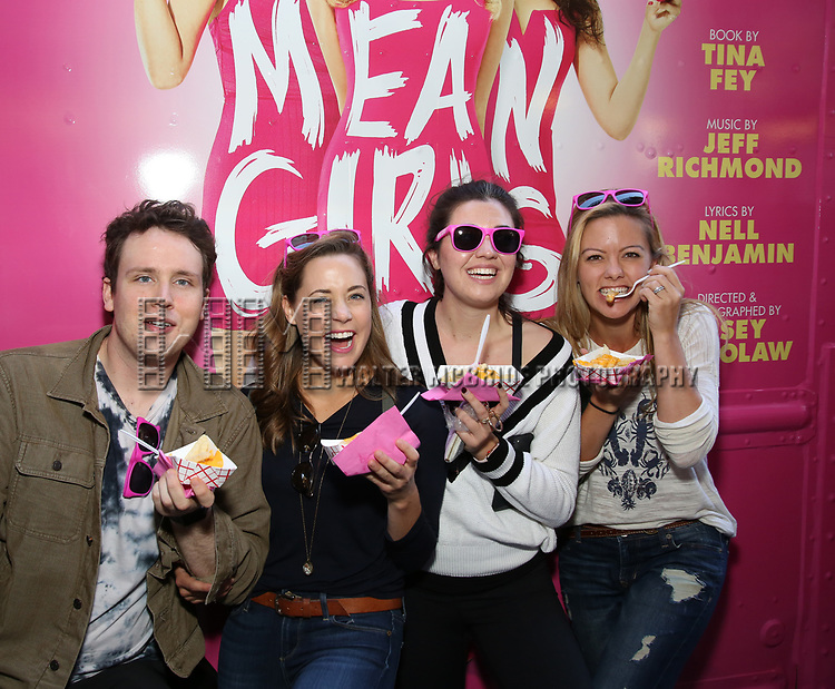 Grey Henson, Erika Henningsen, Barrett Wilbert Weed and Kate Rockwell from 'Mean Girls' cast visits the 'Mean Girls' themed Food Truck in celebration of 'Mean Girls' Box Office Opening Day on Broadway in Times Square on October 3, 2017 in New York City.
