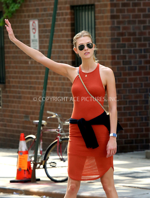 WWW.ACEPIXS.COM<br /> <br /> May 29 2015, New York City<br /> <br /> Model Karlie Kloss wears an orange summer dress as walks in the West Village on May 29 2015 in New York City<br /> <br /> By Line: Philip Vaughan/ACE Pictures<br /> <br /> ACE Pictures, Inc.<br /> tel: 646 769 0430<br /> Email: info@acepixs.com<br /> www.acepixs.com