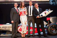 Designer Istvan Kalmar (L), model Reka Ebergenyi (2nd L), McLaren Formula One driver Jenson Button (2nd R) of Britain pose for a photograph on stage during the annual Hugo Boss party just prior to the Hungarian F1 Grand Prix in Budapest, Hungary. Thursday, 28. July 2011. ATTILA VOLGYI