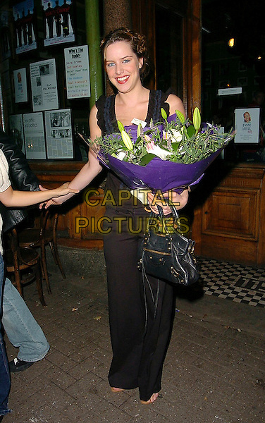 "MICHELLE RYAN.""Who's The Daddy?"" Press Night Party at The King's Head Theatre, London..July 25th, 2005.full length black leather bag purse bouquet flowers.www.capitalpictures.com.sales@capitalpictures.com.©Capital Pictures"