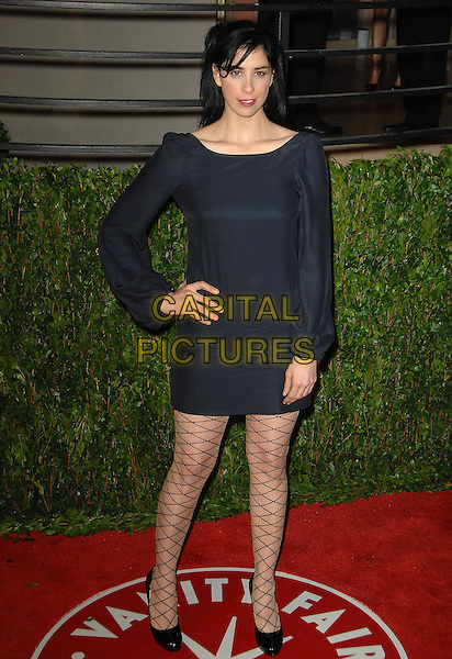SARAH SILVERMAN.The 2010 Vanity Fair Oscar Party held at The Sunset Tower Hotel in West Hollywood, California, USA..March 7th, 2010.oscars full length black dress hand on hip pattern tights long sleeves fishnet .CAP/RKE/DVS.©DVS/RockinExposures/Capital Pictures.