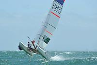 Helm: Darren Bundock / Crew: Nina Curtis (AUS)<br /> Racing -Day 4 / Nacra 17<br /> ISAF Sailing World Cup - Melbourne<br /> Sandringham Yacht Club<br /> Thursday 11 December 2014<br /> &copy; Sport the library / Jeff Crow