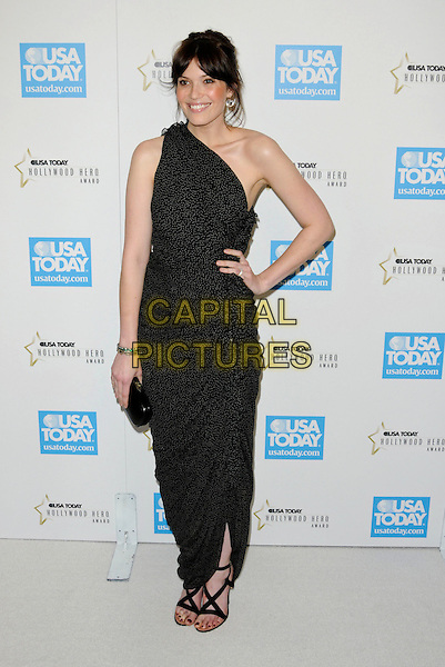 MANDY MOORE .arriving at the USA Today 4th Annual Hollywood Hero Award Honors at the Montage Beverly Hills in Beverly Hills, California, USA, November 10th 2009..full length one shoulder black dress long maxi sandals clutch bag polka dot print hand on hip.CAP/ROT.©Lee Roth/Capital Pictures.