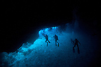 Silas tunnel in Palau has a long section where at one point there is very little light, as you move through the tunnel, the exit becomes visible and appears to radiate a deep blue, typical of the clear waters around Palau Micronesia. (Photo by Matt Considine - Images of Asia Collection)
