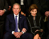 Former United States President George W. Bush and former first lady Laura Bush listen to the speakers at the ceremony honoring former United States President George H.W. Bush, who will Lie in State in the Rotunda of the US Capitol on Monday, December 3, 2018.<br /> Credit: Ron Sachs / CNP<br /> (RESTRICTION: NO New York or New Jersey Newspapers or newspapers within a 75 mile radius of New York City)