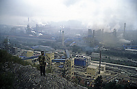 A worker stands on the hill above the factory of Benxi Iron and Steel Group in Liaoning. China's second-largest steelmaker Anshan Iron & Steel Group has merged with smaller rival Benxi Steel Group to create a company with capacity that will match the mainland's biggest steelmaker, Shanghai Baosteel Group..02 Sep 2005