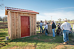 The Busi family and friends use hot irons to christen and brand the new pump shed at their corrals near Jackson, California.