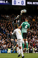 2nd November 2019; Estadio Santiago Bernabeu, Madrid, Spain; La Liga Football, Real Madrid versus Real Betis; Goalkeeper Thibaut Courtois (Real Madrid)  wins the crossed ball and palms away from Zouhair Feddal (Betis) - Editorial Use