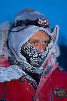 Sebasitan Schneulle is all frosty after arriving at the village checkpoint of Ruby in Interior Alaska during the 2010 Iditarod
