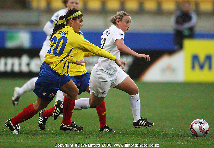 Annalie Longo takes the ball up chased by Vanessa Aponte during the FIFA Women's Under-17 World Cup pool match between New Zealand and Columbia at Westpac Stadium, Wellington, New Zealand on Tuesday, 4 November 2008. Photo: Dave Lintott / lintottphoto.co.nz