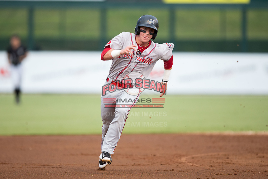Brett Netzer (12) of the Greenville Drive hustles towards third base against the Kannapolis Intimidators at Kannapolis Intimidators Stadium on August 7, 2017 in Kannapolis, North Carolina.  The Drive defeated the Intimidators 6-1.  (Brian Westerholt/Four Seam Images)