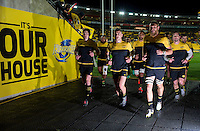 The Hiurricanes run in after warming up for the Super Rugby semifinal match between the Hurricanes and Chiefs at Westpac Stadium, Wellington, New Zealand on Saturday, 30 July 2016. Photo: Dave Lintott / lintottphoto.co.nz