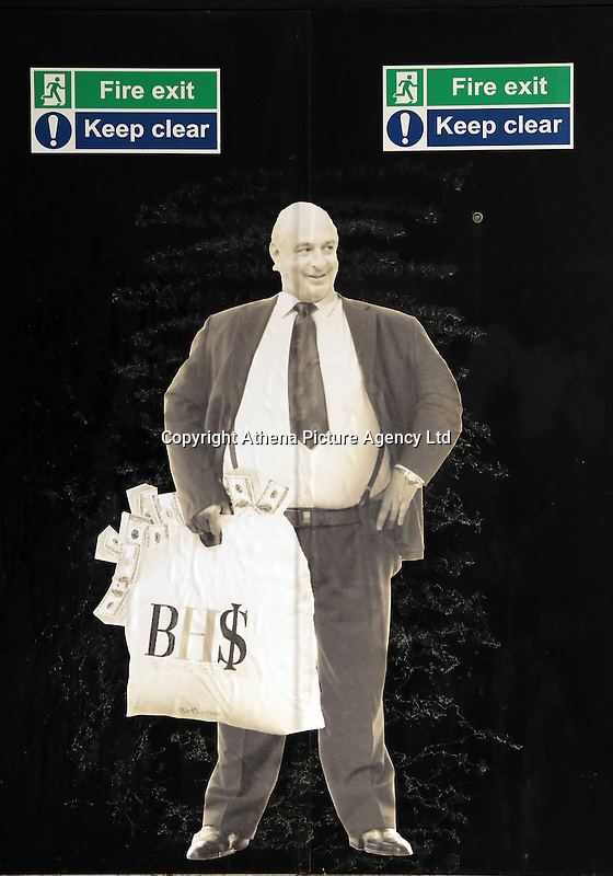 Pictured: A poster of Sir Philip Green on the door of the now closed down BHS store in Oxford Street, Swansea, Wales, UK. Tuesday 13 September 2016<br /> Re: Former owner of BHS, Sir Philip Green has paid a surprise 'visit' to the closed down BHS store in Swansea.<br /> He was spotted in the doorway of the Oxford Street store, which closed its doors for the last time last month.<br /> In his hand was a BHS shopping bag with money spilling out of it.<br /> Sir Philip had owned BHS before selling it for &pound;1 last year.<br /> He is claimed to have taken millions out of the company in dividends and left behind a &pound;571m pensions deficit.<br /> Alongside the poster are the words: &quot;Thankyou for your custom Sir&quot;.