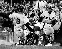 Red Sox Carl Yastrzemski scores ahead of the tag of A's catcher Phil Roof. Reggie Smith (on deck batter)..1969 photo by Ron Riesterer