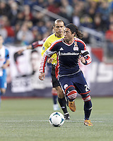New England Revolution midfielder Lee Nguyen (24) brings the ball forward. In a Major League Soccer (MLS) match, the New England Revolution (blue/red) defeated Philadelphia Union (blue/white), 2-0, at Gillette Stadium on April 27, 2013.