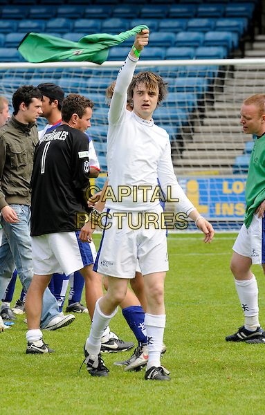 PETE DOHERTY.The Music Industry Soccer Six charity football match, in aid of the Samaritans, held at Millwall FC's New Den ground, London, England. .May 18th 2008 .full length uniform kit white top socks shorts arm in air green flag .CAP/DH.©David Hitchens/Capital Pictures.