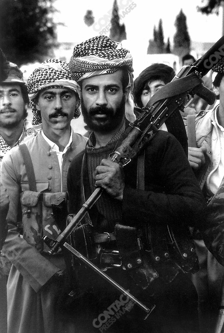 Kurdish rebels gather before making a counterattack on Iraqi positions south of Kirkuk, northern Iraq, March 1991