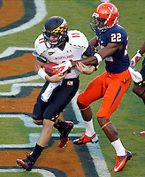 Maryland Terrapins quarterback Perry Hills (11) runs past Virginia Cavaliers cornerback Drequan Hoskey (22) for a touchdown during the game in Charlottesville, Va. Maryland defeated Virginia 27-20.