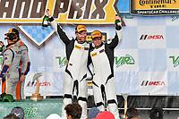 #71 Rebel Rock Racing, Chevrolet Camaro GT4.R, GS: Robin Liddell, Andrew Davis celebrate in victory lane