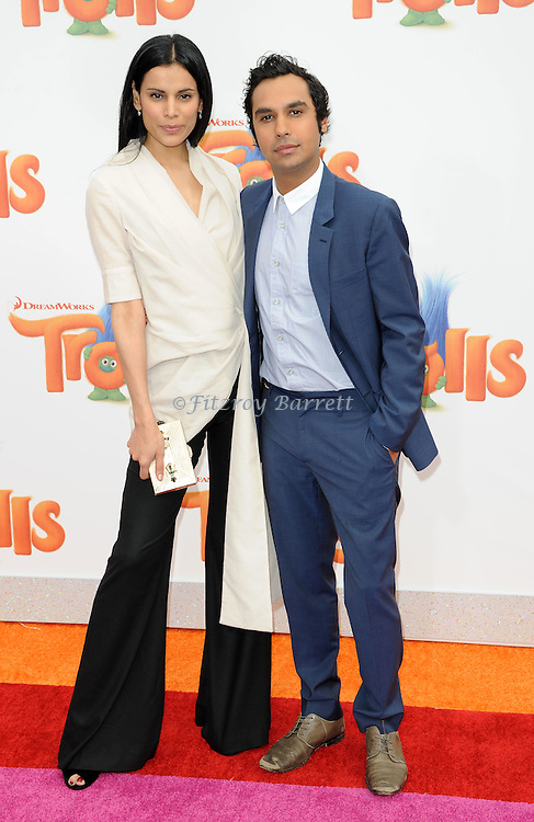 Kunal Nayyar and Neha Kapur arriving at the Los Angeles premiere of Trolls held at the Regency Village Theater Westwood, CA. October 23, 2016.