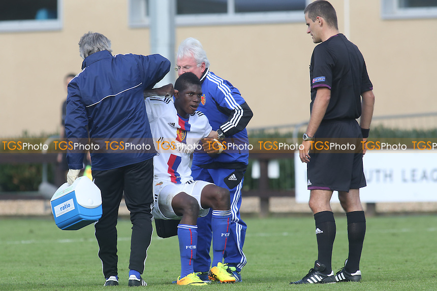 Breel-Donald Embolo of FC Basel is helped up by the trainer/physio after receiving treatment - Chelsea Under-19 vs FC Basel Under-19 - UEFA Youth League Football at Chelsea FC Cobham Training Ground, Surrey - 18/09/13 - MANDATORY CREDIT: Paul Dennis/TGSPHOTO - Self billing applies where appropriate - 0845 094 6026 - contact@tgsphoto.co.uk - NO UNPAID USE