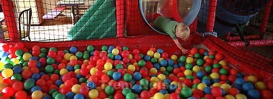 Nathaniel Nelson in the ball pit at McDonald's<br />