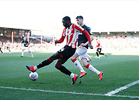 8th February 2020; Griffin Park, London, England; English Championship Football, Brentford FC versus Middlesbrough; Josh Dasilva of Brentford crossing the ball with Paddy McNair of Middlesbrough marking - Strictly Editorial Use Only. No use with unauthorized audio, video, data, fixture lists, club/league logos or 'live' services. Online in-match use limited to 120 images, no video emulation. No use in betting, games or single club/league/player publications