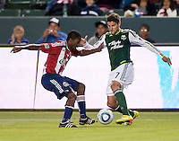 CARSON, CA – June 3, 2011: Portland Timbers midfielder Sal Zizzo (7) attempts to move past Chivas USA defender Michael Lahoud (11) during the match between Chivas USA and Portland Timbers at the Home Depot Center in Carson, California. Final score Chivas USA 1, Portland Timbers 0.