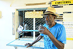 A  customer at a quick order breakfast shop in a neighborhood in Trinidad, Cuba