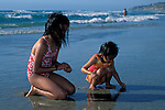 Children playing at the beach,+near Del Mar, San Diego County, CALIFORNIA