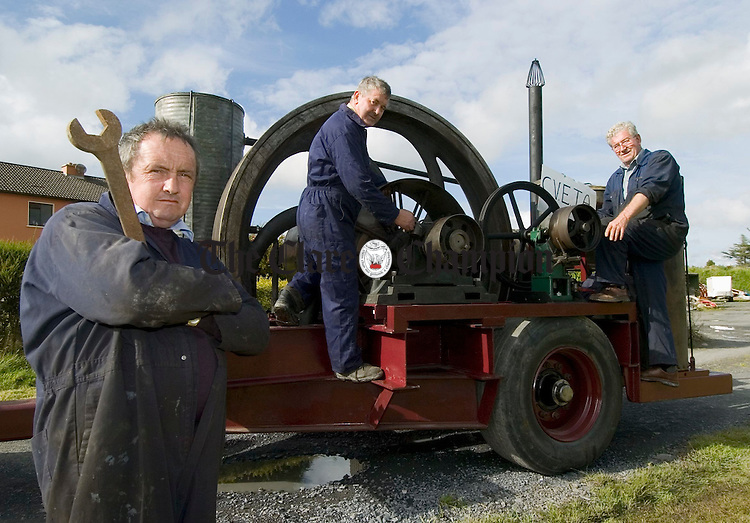 Gerry Keane, Bernard Duggan and Sean Collins, putting the finishing touches to a 1930's National Oil Engine, which has been recently restored following a lifetime of work at the Windgap Creamery in Kilkenny. The engine will be started in public for the first time in 50 years at the Kilmihil Festival Of Fun which takes place on the August Bank Holiday weekend. Photograph by John Kelly.