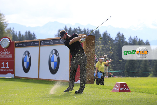 Steven Jones (AUS) tees off the 11th tee during Thursday's Round 1 of the 2014 Omega European Masters held at the Crans Montana Golf Club, Crans-sur-Sierre, Switzerland.: Picture Eoin Clarke, www.golffile.ie: 4th September 2014