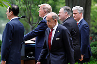 Director of the National Economic Council Larry Kudlow walks behind United States President Donald J. Trump as he delivers remarks on China in the Rose Garden at the White House in Washington on May 29, 2020. Also pictured are, from left to right: US Secretary of the Treasury Steven T. Mnuchin; US Secretary of State Mike Pompeo; and US National Security Advisor Robert C. O'Brien.<br /> Credit: Yuri Gripas / Pool via CNP/AdMedia