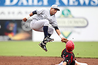 Staten Island Yankees Ali Castillo #60 attempts to tag Garrett Wittels after catching a high throw during a game against the Batavia Muckdogs at Dwyer Stadium on July 28, 2011 in Batavia, New York.  Batavia defeated Staten Island 4-3.  (Mike Janes/Four Seam Images)