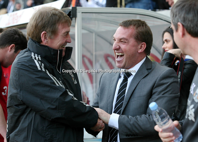 Barclay Premier League, Swansea City (white) V Liverpool (red) Liberty Stadium, 13/05/12<br /> Pictured: The two managers Kenny Dalglish and Brendan Rodgers exchange a laugh before kick off.<br /> Picture by: Ben Wyeth / Athena <br /> info@athena-pictures.com
