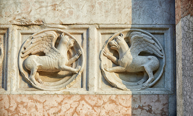 Medieval relief sculptures of mythical griffins on the exterior of the Romanesque Baptistery of Parma, circa 1196, (Battistero di Parma), Italy
