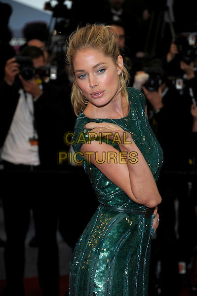 Doutzen Kroes.'Cosmopolis' screening at the 65th  Cannes Film Festival, France..25th May 2012.half length green sequins sequined dress hand blowing kiss side .CAP/PL.©Phil Loftus/Capital Pictures.