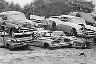 September 1967 --- An auto graveyard in New York City. --- Image by © JP Laffont