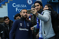 Cenk Tosun of Everton breaks away from the pre-match warm up to have a selfie with some supporters during Chelsea vs Everton, Premier League Football at Stamford Bridge on 11th November 2018