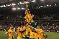 MELBOURNE, 11 JUNE 2013 - Tim CAHILL of Australia celebrates the goal of Lucas NEILL in a Round 4 FIFA 2014 World Cup qualifier match between Australia and Jordan at Etihad Stadium, Melbourne, Australia. Photo Sydney Low for Zumapress Inc. Please visit zumapress.com for editorial licensing. *This image is NOT FOR SALE via this web site.