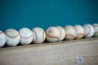 Baseballs sit on top of the bench in the visitors dugout prior to the South Atlantic League game between the Augusta GreenJackets and the Greensboro Grasshoppers at First National Bank Field on April 10, 2018 in Greensboro, North Carolina.  The GreenJackets defeated the Grasshoppers 5-0.  (Brian Westerholt/Four Seam Images)