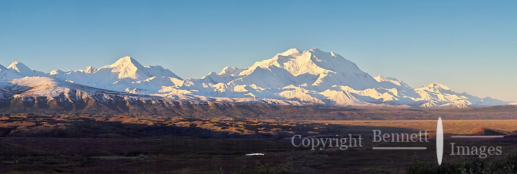 """The sun rises over Mt. McKinley in Alaska. The mountain, also known as Denali, meaning """"The Great One,"""" is North America's tallest peak."""