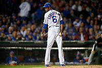 Chicago Cubs pitcher Carl Edwards Jr. (6) checks the runner in the seventh inning during Game 5 of the Major League Baseball World Series against the Cleveland Indians on October 30, 2016 at Wrigley Field in Chicago, Illinois.  (Mike Janes/Four Seam Images)