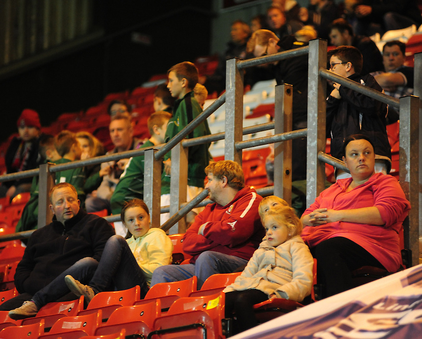 Lincoln City fans watch the Imps game against Tamworth<br /> <br /> (Photo by Chris Vaughan/CameraSport)<br /> <br /> Football - The Skrill Premier - Lincoln City v Tamworth - Tuesady 8th October 2013 - Gelder Group Sincil Bank Stadium - Lincoln<br /> <br /> &copy; CameraSport - 43 Linden Ave. Countesthorpe. Leicester. England. LE8 5PG - Tel: +44 (0) 116 277 4147 - admin@camerasport.com - www.camerasport.com