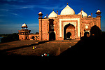 The famous historical monument The Taj Mahal casts its shadow literally on the monument within its complex and on the evening visitors within its complex in Uttar Pradesh, India. Photograph © Santosh Verma