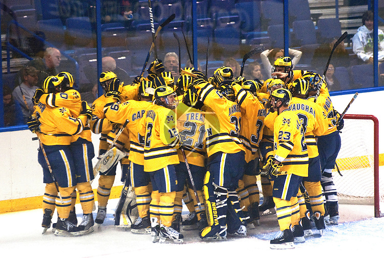 March 25,  2011           The University of Michigan Wolverines celebrate their win after they defeated the University of Nebraska -Omaha Mavericks in a sudden death overtime period 3-2, after regulation time ended with a 2-2 tie.  The officials took several minutes to make a ruling on a goal, which resulted in the Michigan team's win. They will advance after the win in the first semifinal game at the NCAA Division 1 Men's West Regional Hockey Tournament, played on Friday March 25, 2011 at the Scottrade Center in downtown St. Louis.