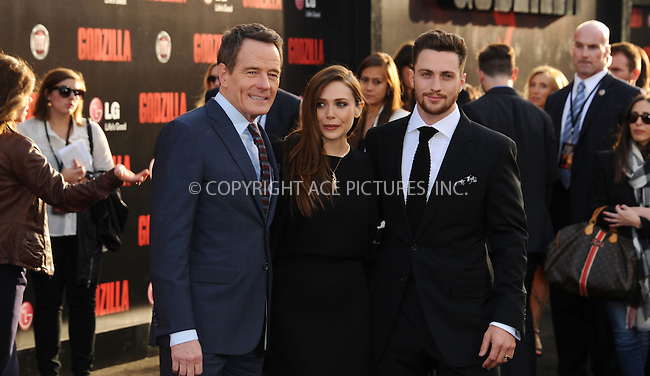 ACEPIXS.COM<br /> <br /> May 8 2014, LA<br /> <br /> (L-R) Bryan Cranston, Elizabeth Olsen and Aaron Taylor-Johnson arriving at the Los Angeles premiere of 'Godzilla' at Dolby Theatre on May 8, 2014 in Hollywood, California. <br /> <br /> By Line: Peter West/ACE Pictures<br /> <br /> ACE Pictures, Inc.<br /> www.acepixs.com<br /> Email: info@acepixs.com<br /> Tel: 646 769 0430