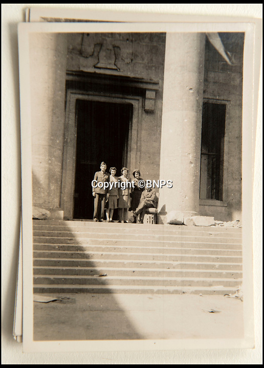BNPS.co.uk (01202 558833)<br /> Pic: C&amp;T/BNPS<br /> <br /> Brenda at Hitler's Reich Chancellery in July 45.<br /> <br /> A humble secretary's remarkable first hand archive of some of the most momentous events of WW2 has come to light.<br /> <br /> 'Miss Brenda Hart' worked in the Cabinet Office during the last two years of the war, travelling across the globe with the Allied leaders as the conflict drew to a close.<br /> <br /> Her unique collection of photographs and momentoes of Churchill, Stalin and other prominent Second World War figures have been unearthed after more than 70 years.<br /> <br /> The scrapbooks, which also feature Lord Mountbatten and Vyacheslav Molotov, were collated by Brenda Hart who, in her role as secretary to Churchill's chief of staff General Hastings Ismay, enjoyed incredible access to him and other world leaders.<br /> <br /> She also wrote a series of letters which give fascinating insights, including watching Churchill and Stalin shaking hands at the Bolshoi ballet in 1944, being behind Churchill as he walked out on to the balcony at the Ministry of Health to to wave to some 50,000 Londoners on VE day and even visiting Hitler's bombed out Reich Chancellery at the end of the war.<br /> <br /> This unique first hand account, captured in a collection of photos, passes, documents and letters are being sold at C&amp;T auctioneers on15th March with a &pound;1200 estimate.