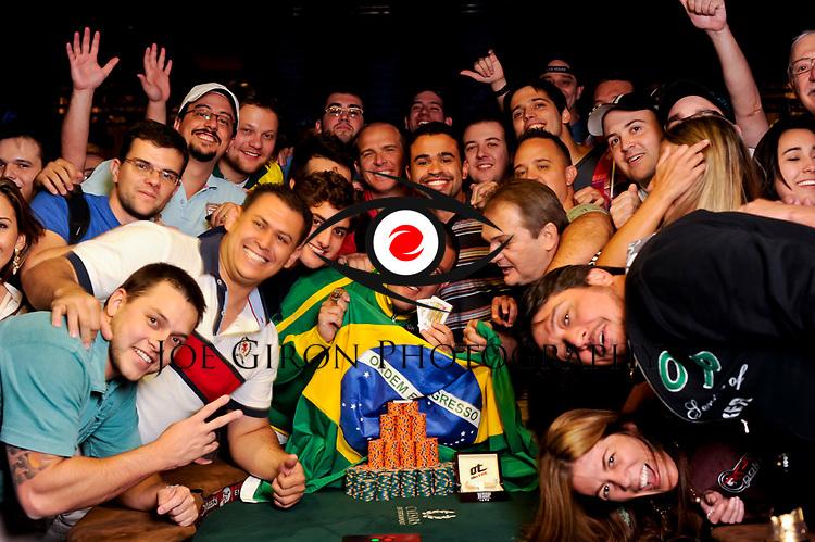 Event 43 bracelet winner Andre Akkari poses with his Brazilian contingent.