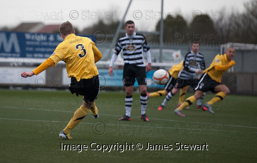 Montrose's Paul Watson scores their first goal.